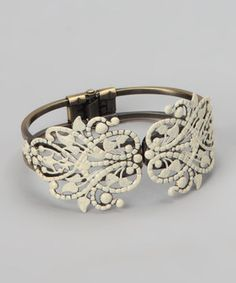 Draw attention to a dainty wrist with this vintage-inspired cuff. A discreet hinge in the back of this bracelet makes it easy to slip on and off, while the intricate cutout pattern adds modern romance to any season's ensemble.