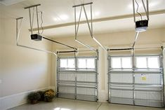 Automatic garage doors can generate a staggering amount of noise. Direct-drive openers with a direct-current motor have fewer moving parts, and the DC technology allows soft starts and stops, all of which contribute to a quieter opening system. Garage Door Trim, Garage Door Company, Garage Door Hardware, Garage Door Windows, Overhead Garage Door, Garage Door Makeover, Garage Door Design, Garage Door Repair, Electric Garage Door Opener