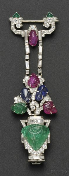 """Art Deco """"Tutti Frutti"""" Pendant Watch, Mauboussin, France, designed as a carved emerald flowerpot with carved ruby, sapphire, and emerald blossoms, and transitional-, old single-, baguette-, and fancy-cut diamonds, enclosing 18-jewel manual-wind movement no. 3250, case no. 275, lg. 3 1/8 in., maker's mark and guarantee stamps, signed movement and watch case. @Deidra Brocké Wallace"""
