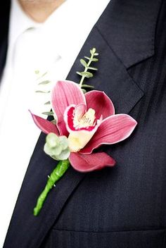 Cymbidium orchids make rather stylish Boutonnieres, Chris's suit was by Gieves and Hawkes.