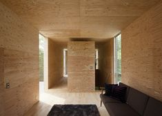 +node cantilevered wooden house by UID Architects