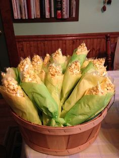 Baggies of popcorn wrapped in tissue paper to look like corn on the cob. Cute for a fall holiday party!