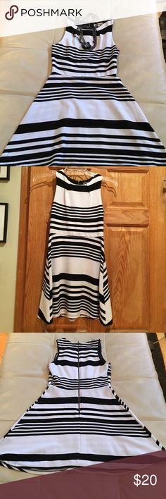 Black and white striped dress Adorable black and white dress. Back zipper Size M Monteau Dresses