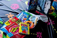 80s Party - use sunglasses, VHS tapes, candy, Rubik's cubes and trading cards to decorate the center of the tables and as party favors.