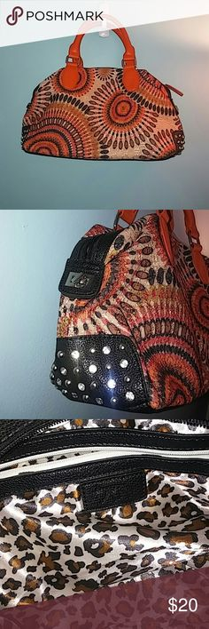 "New Orange patterned bucket bag Orange multi pattern bucket bag; sides are embelished with leaher like material and rhinestones; silver hardware; inside has one zippered pocket and 2 multifunctional pockets; cheetah print lining; 9"" tall x 15"" wide x 5"" deep; never used; Bags"