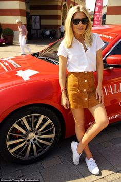 Leggy look: Mollie donned a fashionable, A-line suede mini skirt with buttons down the fro...