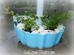 Spray paint an old Bundt cake pan, then slip your patio umbrella through it to make a unique tabletop planter! via So Love That