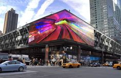 World's largest LED facade, Mediamesh by GKD wrapping the Port Authority Bus Terminal- transparent design allows natural ventilation and reduces solar heat gain