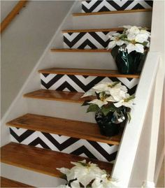 Love this idea for the stairs going up to the bedroom or even better a strip of tin tiles where the black and white are.