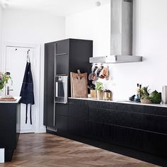 White Dark Wood Kitchen - Take a look inside the Scandinavian home of stylist Pernille Teisbaek - kitchen ideas on HOUSE by House & Garden.