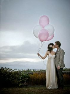 Bride and groom with pink and white balloons