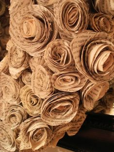 make paper roses from old books
