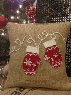 hand crafted burlap pillow with mittens made from recycled wool sweaters #thelittlegreenbean #indigo #magicalholiday