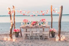 For their beach elopement, this couple opted for flowers everywhere, from garlands strung with fairy lights to vases on the table and on the sand.