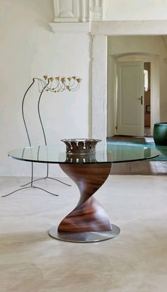 Elika by Porada is a round glass dining table has developed into a firm favorite among designers and architects. The unique twisted base makes it one of the most stylish modern dining tables out there. Oval and elliptical glass and wooden tops are also in production.