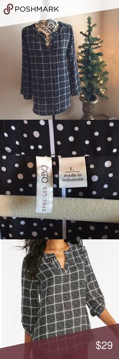 Black and white windowpane polka dot top Black and white windowpane polka dot top features mixed polka dot and windowpane print and an exaggerated high-low hemline. 3/4 sleeves which can be rolled and buttoned or left down. 100% polyester makes this top machine washable and easy to care for! Worn 1x - EUC! Cato Tops Blouses