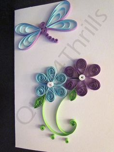This handcrafted greeting card features two beautifully quilled flowers, one purple and one light blue, and a quilled dragonfly in the same colors. There is also a matching quilled gift tag featuring a light blue flower with green stems and leaves. The card measures approx. 4 x 5.5 and was left blank on the inside to allow for more room to add personalization and comes with a protective insert and envelope for mailing. ********************************************* For other cards and gift...