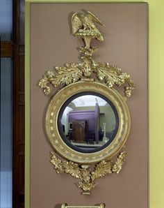 mirror, c.1800, gilde pine with convex glass. Such mirrors were often hung at the end of a room to reflect the entire of the interior.