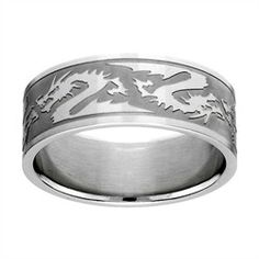 Jacob's Engraved Dragon Ring - Final Sale  Men wear jewelry besides wedding bands, so we've beefed up our collection of men's rings! Jacob's Engraved Dragon Ring is a thick, stainless steel band with shining Chinese dragons along the border. The edges are shiny as well, making the forms distinct against the brushed metal background. Makes a great gift for the Martial Arts aficionado in your life.