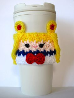 Leave it to Sailor Moon to help keep your coffee insulated and hands protected from hot beverages. This hand knit cozy comes in a charming crochet design and will fit snug over any standard sized coffee house cup. #sailormoon #kawaii #coffee #anime #manga #merchandise