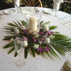 Orchid and Palm Leaf Tropical Beach Wedding Centerpiece