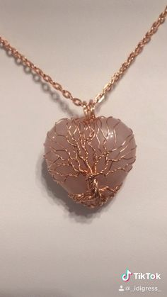 Making a custom tree of life on Rose Quartz heart - Making a custom tree of life on Rose Quartz heart B'Jeweled DZines takes commissions! Wire Jewelry Designs, Handmade Wire Jewelry, Resin Jewelry, Wire Wrapped Jewelry, Jewelry Crafts, Beaded Jewelry, Jewelry Patterns, Jewellery Diy, Wire Wrapped Pendant