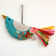 The Linen Cat | little bird ornament (or change purse perhaps?) Like the ribbon for tail feathers.
