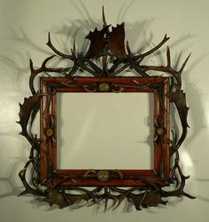 wonderful wood frame with antlers, horn roses and wild boar tusks ca. 1880