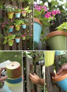 Colorful Vertical DIY Garden On A Fence  diy ideas success-at-home.com