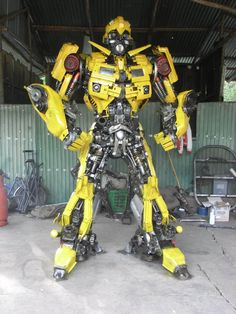 Transformers sculpted from car parts, by Anchalee Saengtai.