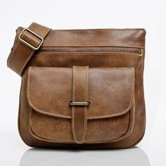 Roots Canada  Side Saddle in Tribe Leather with Brass Hardware | Roots Original flat bags | Roots Canada -I love my new crossbody purse