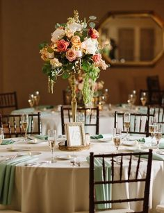 Featured Photographer: Natalie Franke Photography; Sophisticated orange flower wedding reception centerpiece