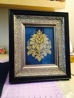 DIY stencil on fabric and then framed by me