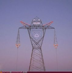 There's an electrical tower in Villa Martelli, Argentina that looks like a giant robot. Coloso, the giant robot shaped electrical tower was created for Tecnópolis 2012 by Buenos Aires-based art collective Doma. Transmission Tower, Street Art, Power Tower, Urban Intervention, Robot Design, Design Art, Argentine, City Art, Installation Art