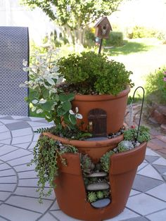 Fairy Garden out of broken pots and a little imagination.  I used a dremel with a tile cutting blade to cut the front opening and sandpaper to smooth the edges.