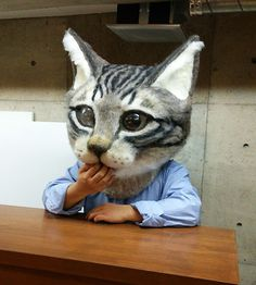 This enormous, super-realistic cat-head mask was needle-felted out of sheep's wool felt by needle-felting expert Housetu Sato and his students at the Japan School Of Wool Art. Description from tumblr.com. I searched for this on bing.com/images