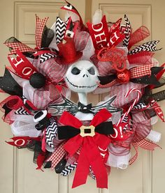 A red/black/white Christmas wreath shipped all the way to the United Kingdom! Message me to order your customized wreath and visit my online shop for my inventory. https://www.etsy.com/shop/wondrouswreath