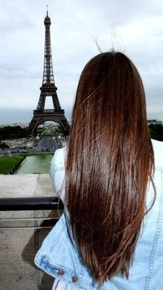 Long gorgeous brunette hair style. And look she loves to travel. Can you say win, win?