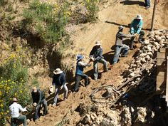 Working together to build their water reservoir with Mano a Mano in Choquechampi. Community volunteers donated more than 32,000 hours to this project!