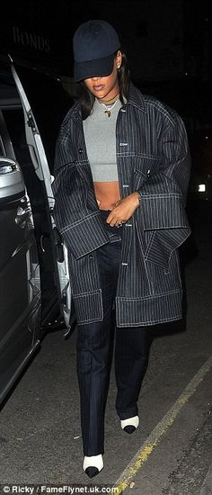 Abs-olutely stunning!Teamed with a grey crop top, Rihanna offered a glimpse at her enviably toned abs, whilst her modelesque pins were elongated with a pair of navy suit trousers