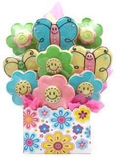 Flower Power    Send this cheerful cookie bouquet and the recipient is sure to have a great day!  Our Flower Power cookie arrangement comes in two sizes- a 6 cookie bouquet (4 smiley flower cookies and 2 butterfly cookies or a 9 cookie bouquet (4 smiley cookies, 3 butterfly cookies and 2 3D flower cookies.)      http://www.littlegiftbasketboutique.com/item_617/Flower-Power.htm