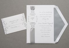 Wedding Ideas Invitations by Wedding Invitations -The Office Gal features this Classic silver satin ribbon is laced through a die-cut surrounded by beautiful scrollwork with your wedding day wording printed in raised lettering. Elegant wedding invitations.