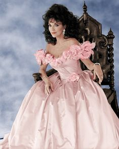Joan says: 'I adore this gorgeous petal pink satin gown designed by the Emanuels, who crea. Pink Satin Dress, Satin Gown, Satin Dresses, Der Denver Clan, Dame Joan Collins, Glamour, Bridal Fashion Week, Beautiful Actresses, Wedding Gowns