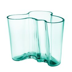 The legendary silhouette of the Aalto vase has been created in many shapes, sizes, and colors by Iittala since the 1937 World's Fair in Paris.  The design by Alvar Aalto has become synonymous with Scandinavian and Finnish design across the world.
