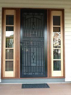 Heritage style screen door with bespoke hardwood sidelights. Beautiful work by D. Schincariol at Dimbulah, FNQ.