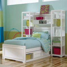 Interesting idea using bookshelves instead of night stands for storage in a small bedroom.