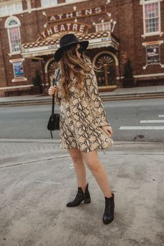 Spring transition outfit styled with snakeskin dress, black ankle booties, and black hat #bohooutfit #edgyoutfit #springoutfit #blackbooties