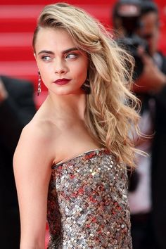 cara has a fantastic look with that red lip accent. try Kosas in Electra