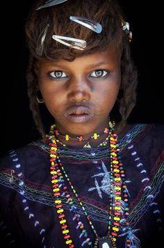 Africa | Young Wodaabe girl photographed at a remote desert market in Niger | ©John Kenny
