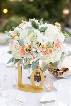 gold table numbers and rose centerpiece @weddingchicks